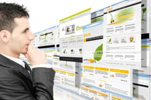 man looking at website designs